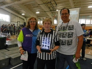 Carol Perrotto (center) presented award by Rosanne Danner, FRC 316 and John Larock, FRC 365